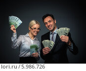 Купить «Богатство. Деловые мужчина и женщина с деньгами», фото № 5986726, снято 19 декабря 2013 г. (c) Raev Denis / Фотобанк Лори