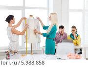 Купить «Две девушки в дизайн-студии работают над созданием нового костюма, делая замеры на манекене», фото № 5988858, снято 17 мая 2014 г. (c) Syda Productions / Фотобанк Лори