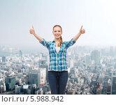 Купить «Позитивная девушка подняла вверх обе руки и показывает жест одобрения», фото № 5988942, снято 12 февраля 2014 г. (c) Syda Productions / Фотобанк Лори