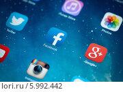 Купить «Иконки социальных сетей на экране смартфона», фото № 5992442, снято 9 мая 2014 г. (c) Александр Лычагин / Фотобанк Лори