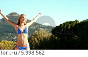 Купить «Beautiful blonde enjoying the sunshine in bikini», видеоролик № 5998562, снято 5 июня 2020 г. (c) Wavebreak Media / Фотобанк Лори