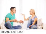 Купить «Молодая пара ссорится дома», фото № 6011354, снято 16 февраля 2014 г. (c) Syda Productions / Фотобанк Лори