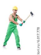 Рабочий в зеленом комбинезоне и каске с топором. Стоковое фото, фотограф Elnur / Фотобанк Лори