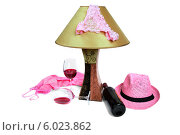 Трусики на лампе, рядом бутылка вина и два бокала. Стоковое фото, фотограф Владимир Ходатаев / Фотобанк Лори