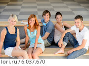 Group of college students sitting looking camera. Стоковое фото, фотограф CandyBox Images / Фотобанк Лори