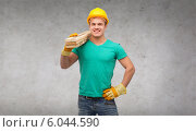 Купить «smiling manual worker in helmet with wooden boards», фото № 6044590, снято 21 января 2020 г. (c) Syda Productions / Фотобанк Лори