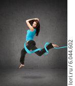 Купить «beautiful sporty woman jumping in sportswear», фото № 6044602, снято 14 ноября 2013 г. (c) Syda Productions / Фотобанк Лори