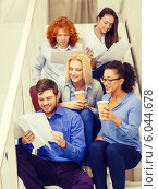 Купить «team with papers and take away coffee on staircase», фото № 6044678, снято 1 февраля 2014 г. (c) Syda Productions / Фотобанк Лори