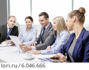 Купить «business team with tablet pc having discussion», фото № 6046666, снято 9 ноября 2013 г. (c) Syda Productions / Фотобанк Лори