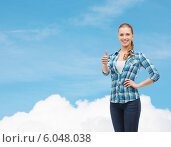 Купить «young woman in casual clothes showing thumbs up», фото № 6048038, снято 12 февраля 2014 г. (c) Syda Productions / Фотобанк Лори