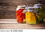 Купить «Vegetable preserves on wooden background», фото № 6048066, снято 5 апреля 2014 г. (c) Майя Крученкова / Фотобанк Лори