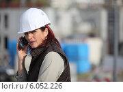 Купить «Female construction worker on site with a phone», фото № 6052226, снято 29 октября 2009 г. (c) Phovoir Images / Фотобанк Лори