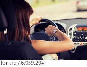 Купить «woman driving a car and looking at watch», фото № 6059294, снято 5 июля 2013 г. (c) Syda Productions / Фотобанк Лори