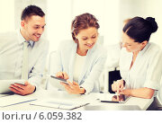 Купить «business team working with tablet pcs in office», фото № 6059382, снято 9 июня 2013 г. (c) Syda Productions / Фотобанк Лори