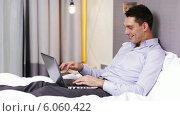 Купить «Businessman working with laptop computer in hotel», видеоролик № 6060422, снято 3 декабря 2013 г. (c) Syda Productions / Фотобанк Лори