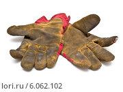 Пара грязных перчаток на белом фоне. Стоковое фото, фотограф Федорец Артем / Фотобанк Лори