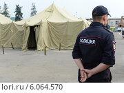 Купить «Временный палаточный лагерь для нелегальных мигрантов», фото № 6064570, снято 1 августа 2013 г. (c) Free Wind / Фотобанк Лори