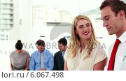 Купить «Interviewers smiling at camera in front of applicants», видеоролик № 6067498, снято 9 августа 2019 г. (c) Wavebreak Media / Фотобанк Лори