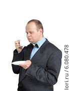 Мужчина в костюме пьет чай. Стоковое фото, фотограф Александр Власик / Фотобанк Лори