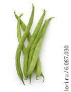 Купить «Green beans handful isolated on white background cutout», фото № 6087030, снято 10 апреля 2014 г. (c) Natalja Stotika / Фотобанк Лори