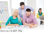 Купить «smiling interior designers working in office», фото № 6087782, снято 17 мая 2014 г. (c) Syda Productions / Фотобанк Лори