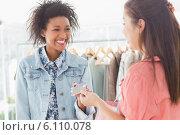 Купить «Customer receiving credit card from saleswoman», фото № 6110078, снято 5 ноября 2013 г. (c) Wavebreak Media / Фотобанк Лори