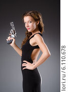 Купить «Woman with gun against dark background», фото № 6110678, снято 11 сентября 2013 г. (c) Elnur / Фотобанк Лори