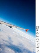 Купить «Airplane wing out of window», фото № 6110702, снято 12 октября 2013 г. (c) Elnur / Фотобанк Лори