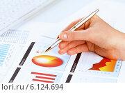 Купить «Analyzing report», фото № 6124694, снято 15 января 2014 г. (c) Sergey Nivens / Фотобанк Лори