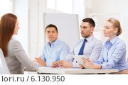 business team interviewing applicant in office. Стоковое фото, фотограф Syda Productions / Фотобанк Лори