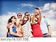 Купить «group of friends taking picture with smartphone», фото № 6131150, снято 31 августа 2013 г. (c) Syda Productions / Фотобанк Лори