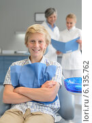 Купить «Teenager boy dental checkup dentist and assistant», фото № 6135762, снято 22 июня 2014 г. (c) CandyBox Images / Фотобанк Лори