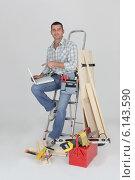 Купить «Carpenter with a laptop», фото № 6143590, снято 25 ноября 2009 г. (c) Phovoir Images / Фотобанк Лори