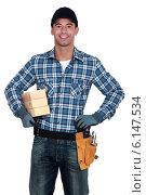 Купить «Manual worker with wood», фото № 6147534, снято 31 марта 2011 г. (c) Phovoir Images / Фотобанк Лори