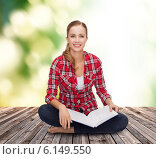 Купить «smiling young woman sitting on floor with book», фото № 6149550, снято 19 января 2014 г. (c) Syda Productions / Фотобанк Лори