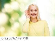 Купить «smiling young woman listening to gossip», фото № 6149718, снято 15 апреля 2014 г. (c) Syda Productions / Фотобанк Лори