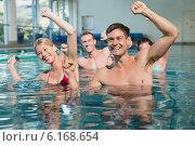 Купить «Fitness class doing aqua aerobics», фото № 6168654, снято 10 апреля 2014 г. (c) Wavebreak Media / Фотобанк Лори