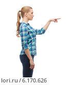 Купить «young woman pressing imaginary button», фото № 6170626, снято 12 февраля 2014 г. (c) Syda Productions / Фотобанк Лори