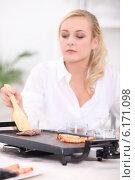 Купить «Woman using griddle», фото № 6171098, снято 22 октября 2010 г. (c) Phovoir Images / Фотобанк Лори