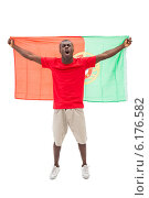 Купить «Excited portugal football fan in red cheering», фото № 6176582, снято 30 апреля 2014 г. (c) Wavebreak Media / Фотобанк Лори