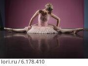Купить «Graceful ballerina sitting with legs stretched out», фото № 6178410, снято 23 апреля 2014 г. (c) Wavebreak Media / Фотобанк Лори