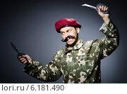Купить «Funny soldier against the dark background», фото № 6181490, снято 26 апреля 2014 г. (c) Elnur / Фотобанк Лори