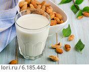 Купить «Almond milk in glass with almonds», фото № 6185442, снято 8 июля 2014 г. (c) Tatjana Baibakova / Фотобанк Лори