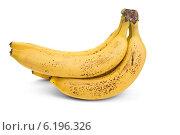 Купить «Гроздь бананов с темными точками на кожуре на белом фоне», фото № 6196326, снято 20 июля 2014 г. (c) Владимир Ходатаев / Фотобанк Лори