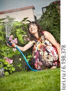 Купить «Woman in the garden.», фото № 6198378, снято 14 декабря 2019 г. (c) BE&W Photo / Фотобанк Лори