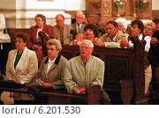 A German church service, Gora Swietej Anny, Poland (1996 год). Редакционное фото, агентство Caro Photoagency / Фотобанк Лори