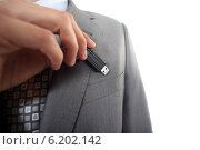 Купить «Businessman with USB key in hand», фото № 6202142, снято 4 апреля 2011 г. (c) Phovoir Images / Фотобанк Лори