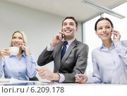 Купить «business team with smartphones having conversation», фото № 6209178, снято 9 ноября 2013 г. (c) Syda Productions / Фотобанк Лори