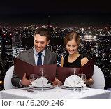 Купить «smiling couple with menus at restaurant», фото № 6209246, снято 9 марта 2014 г. (c) Syda Productions / Фотобанк Лори