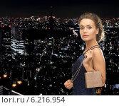 Купить «happy woman in evening dress with small bag», фото № 6216954, снято 17 марта 2013 г. (c) Syda Productions / Фотобанк Лори